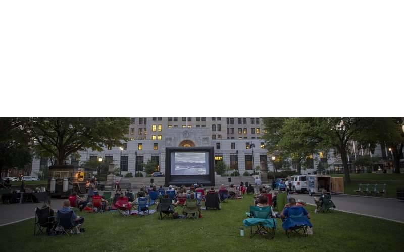people watching outdoor evening movie