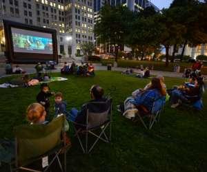 people watching outdoor evening movie