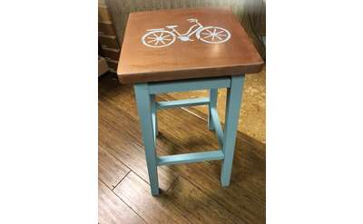 stool with bicycle painted on it