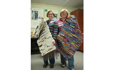 Two People Holding Rugs Photo