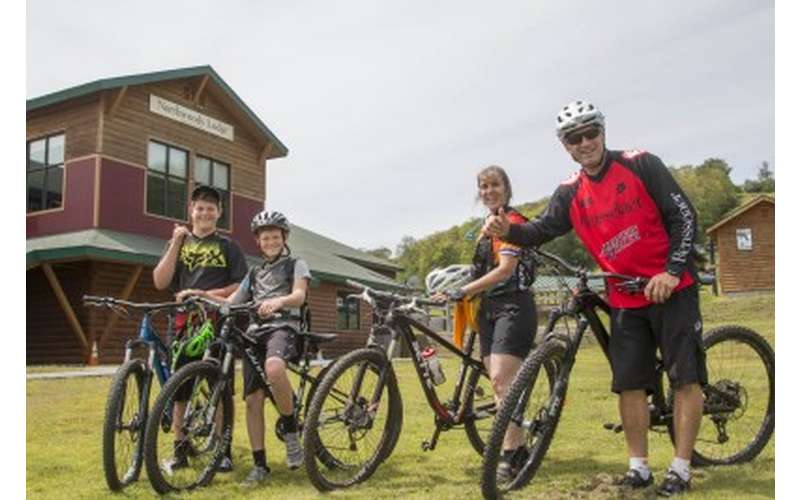 Excited Mountain Bikers in Skills Development Class posing with Bikes for Group Photo