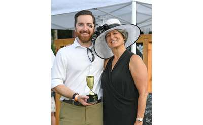 two people dressed up with croquet trophy
