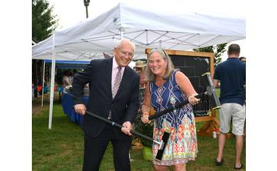 Paul Tonko and Mayor Meg Kelly with croquet mallets