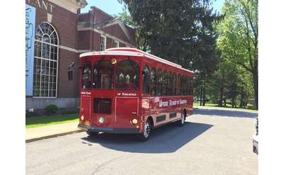 red trolley outside the Saratoga Auto Museum