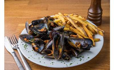 Moules Frites in a light white wine shallot sauce