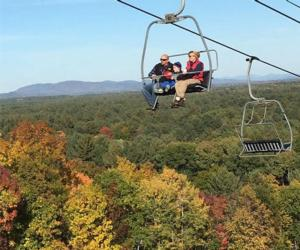 people on a chairlift in fall