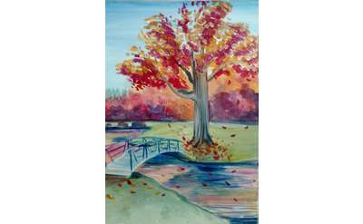 A park scene with a little arch bridge across a pond leading an old, large tree with autumn leaves.