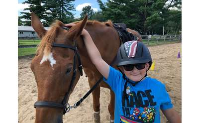 kid with a horse