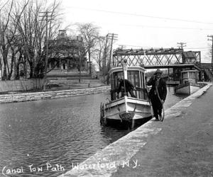 people and boat using the champlain canal tow path