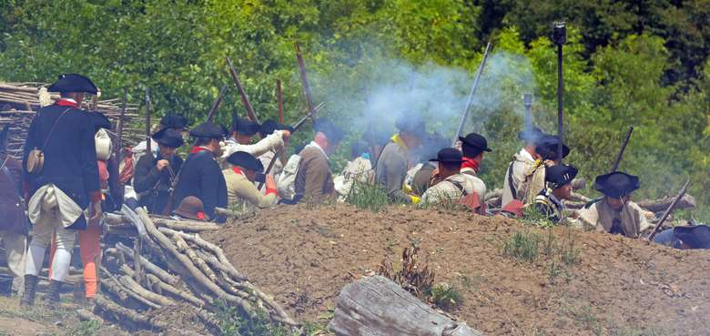 Soldiers in recreated dirt redoubt as part of Defiance & Independence Battle Reenactment July 18-19, 2020.