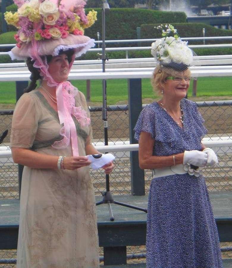 two women with fancy hats
