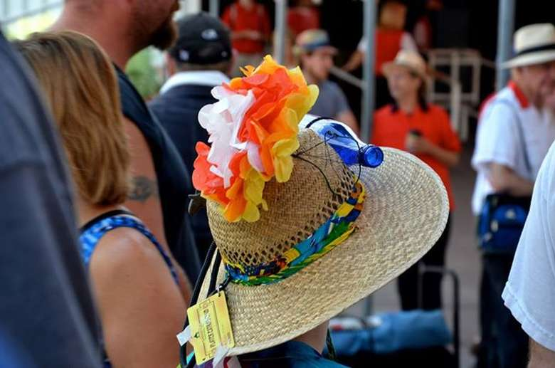 a hat with orange and yellow decorations