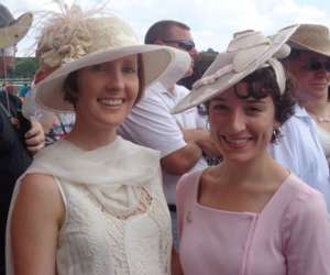 two women wearing fancy hats
