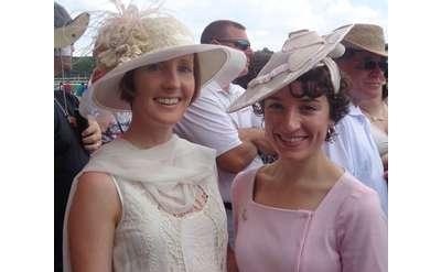 two women wearing fancy hats