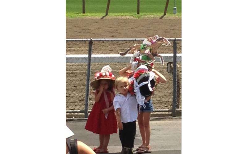 kids standing near the race track