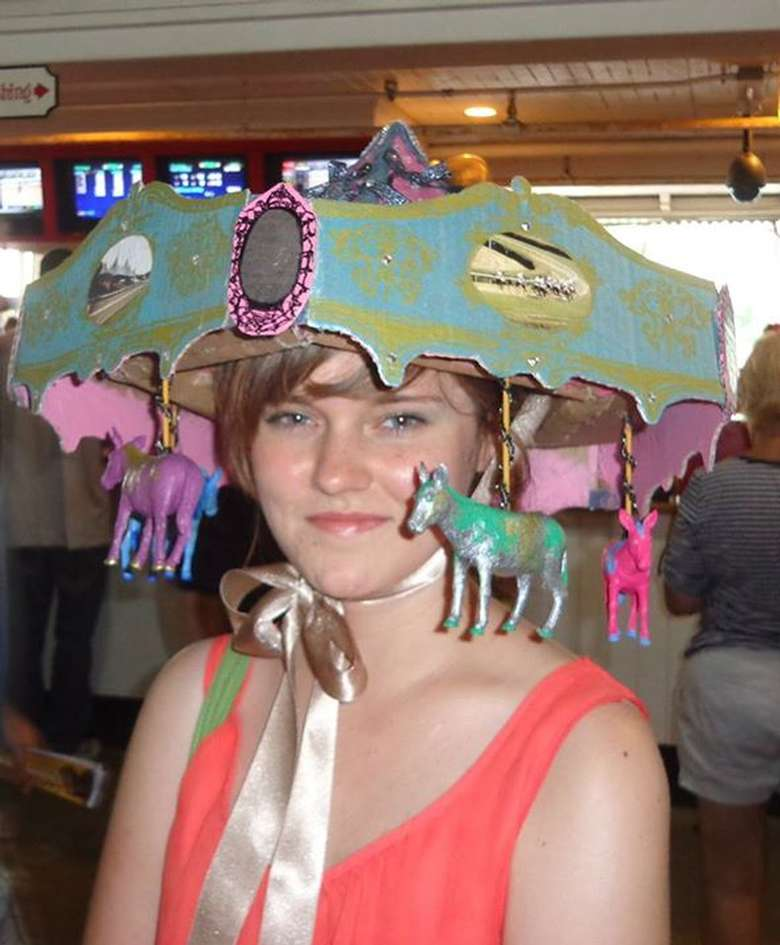 woman with a hat in the shape of a carousel
