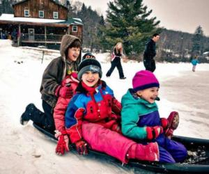 kids sledding together