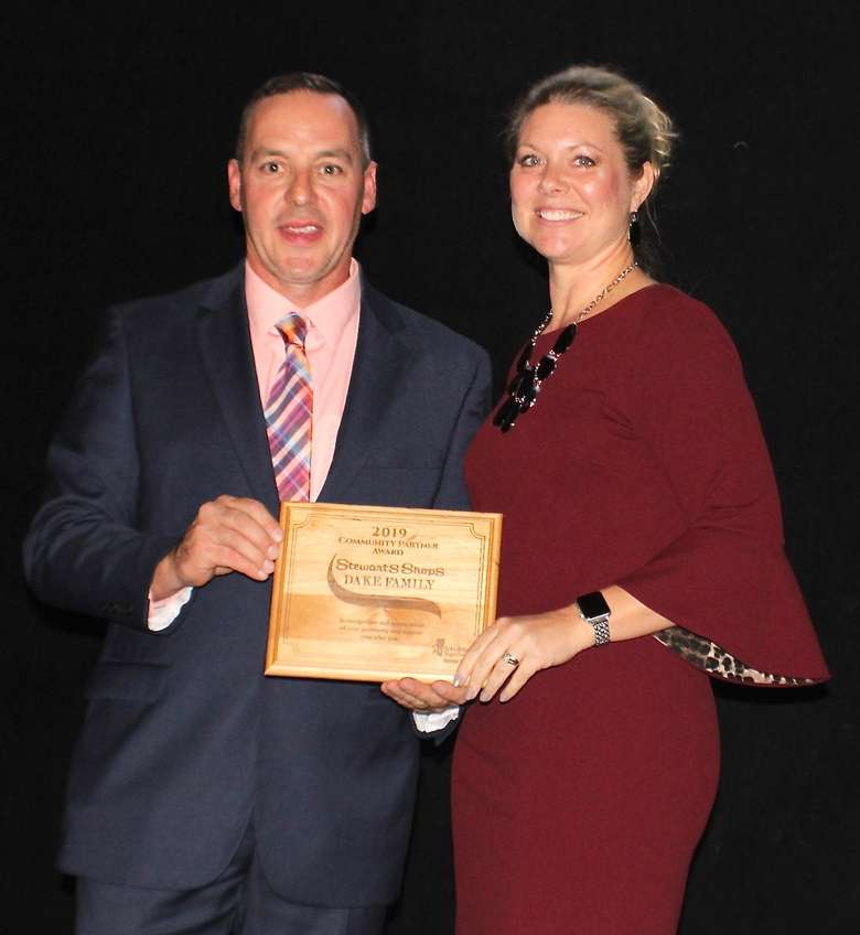 Amy Potter accepts 2019 Community Partner Award for Stewart's Foundation/Dake Family; pictured with Paul Lambert