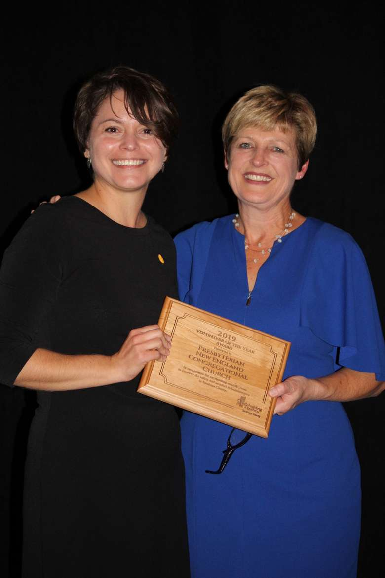 On behalf of the Presbyterian New England Congregational Church, Pastor Kate Forer accepts 2019 Volunteer Group of the year; pictured with Executive Director Michelle Larkin