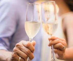 Couple clinking champagne glasses