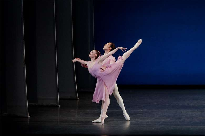 two dancers performing in piano pieces