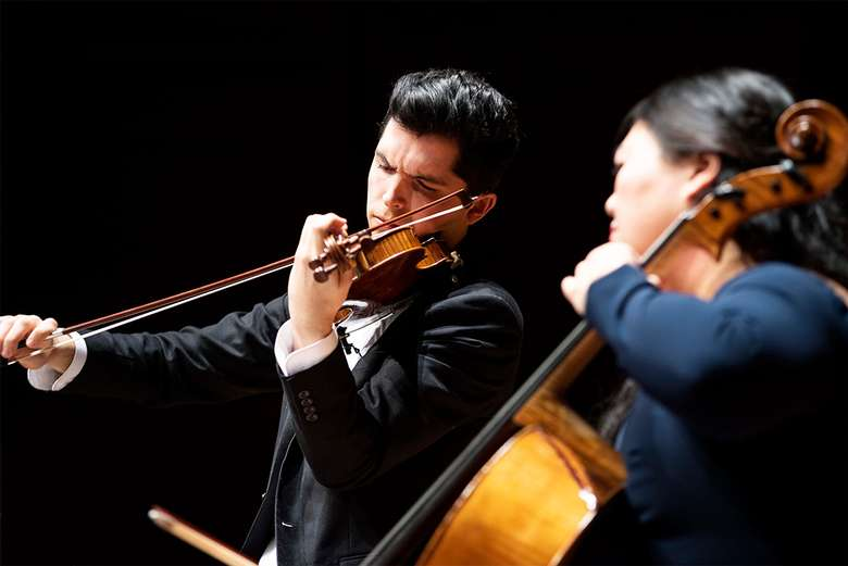a violinist and a cellist performing