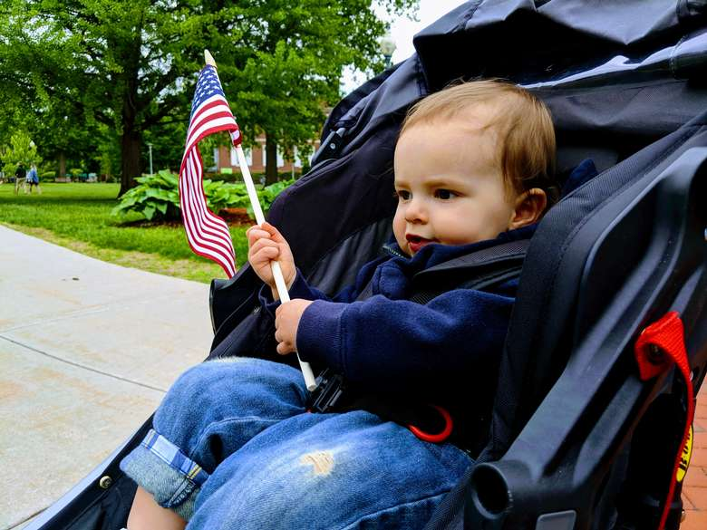 toddler with flag