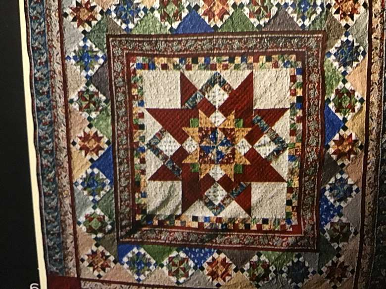 Raffle Quilt. A medallion pattern by Nancy Rink Designs. 90 x 90 inches