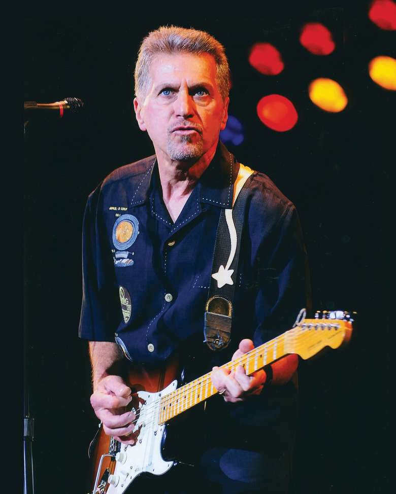Johnny Rivers playing guitar