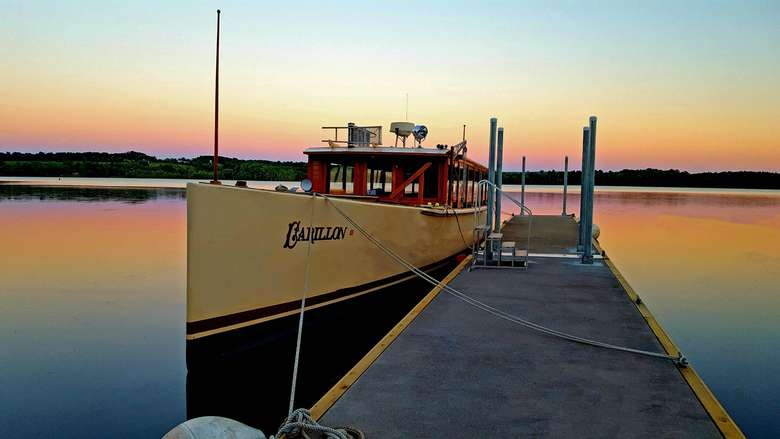 The Carillon tour boat docked on Lake Champlain at sunset.