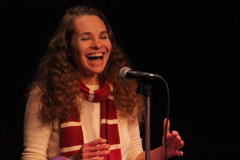 A storyteller at a Howl Story Slam event. Photo credit: Baylee Annis, ACW