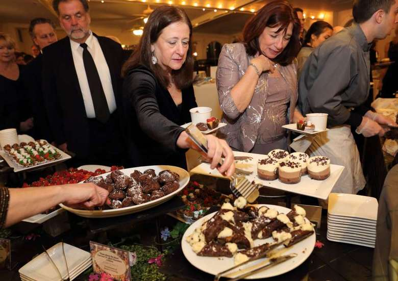 Guests Enjoying Array of Chocolate Desserts