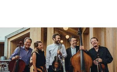 five musicians smiling