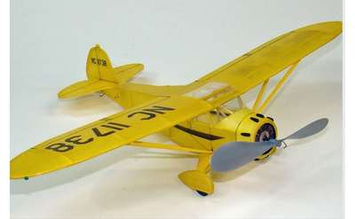 small yellow model airplane