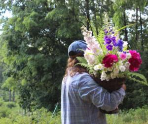 person carrying large bouquet of flowers