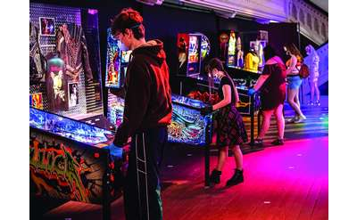 people playing pinball