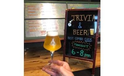 Trivia night chalkboard sign with beer