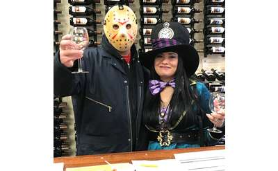 two people in halloween costumes during a wine tasting
