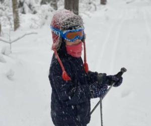 kid in ski clothes