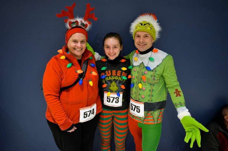 three festive people in holiday outfits