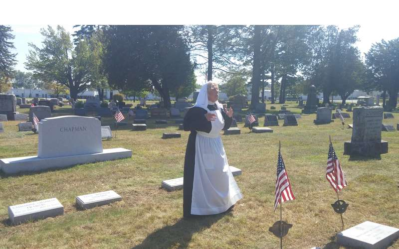 women reenactor in cemetery