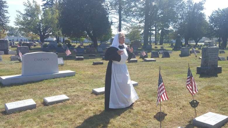 women reenactor in cemetery