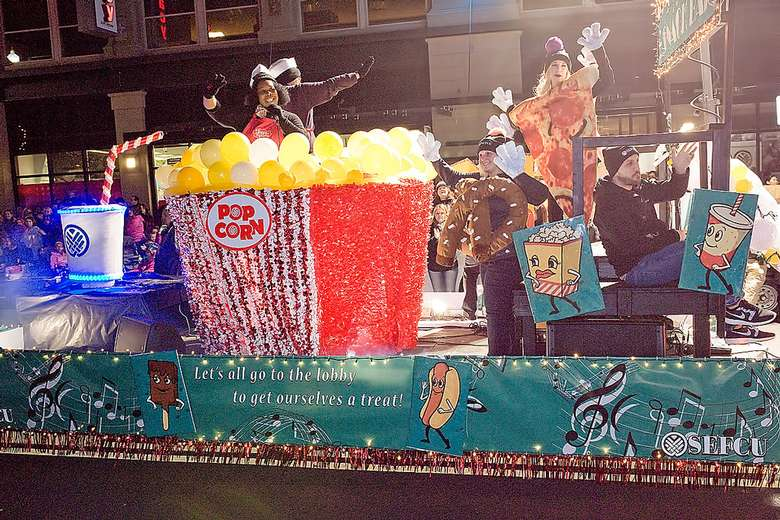 float with giant popcorn in parade