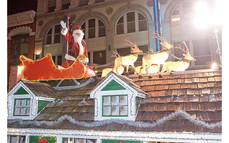 Santa and reindeer on roof in parade