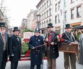group of men dressed in Victorian period attire