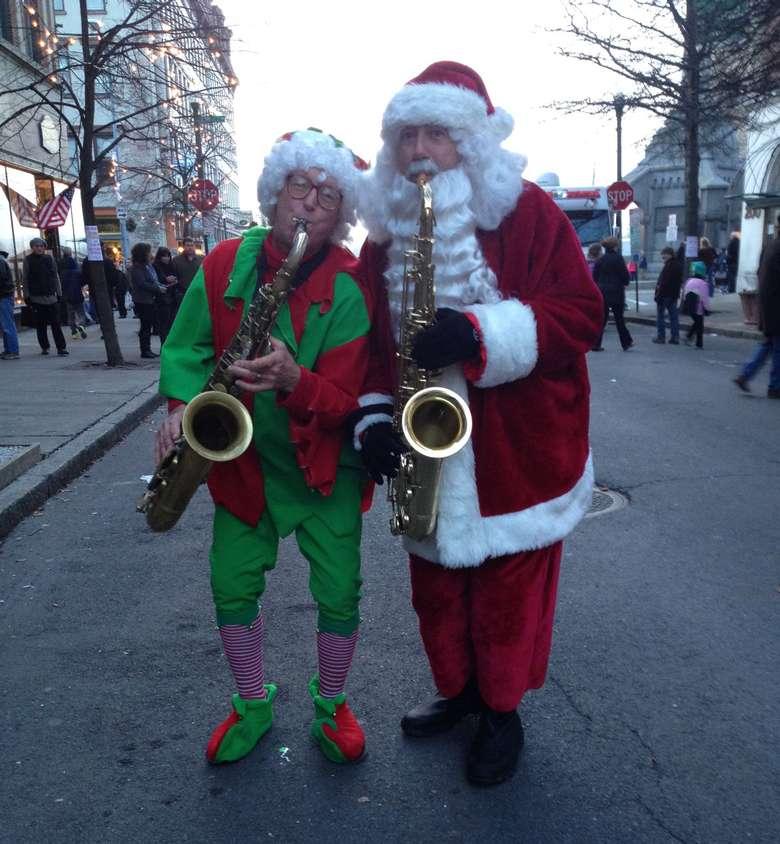 saxophone Santa and an elf