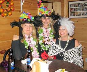 three women dressed up as witches for celebration