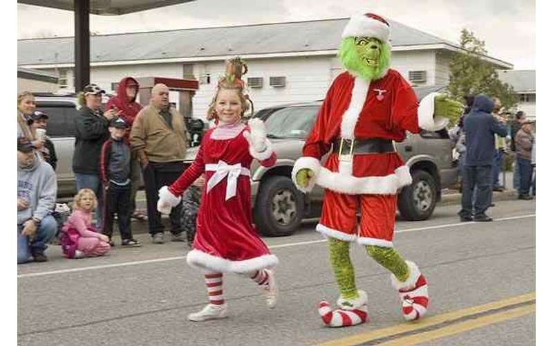 little girl and Grinch in parade