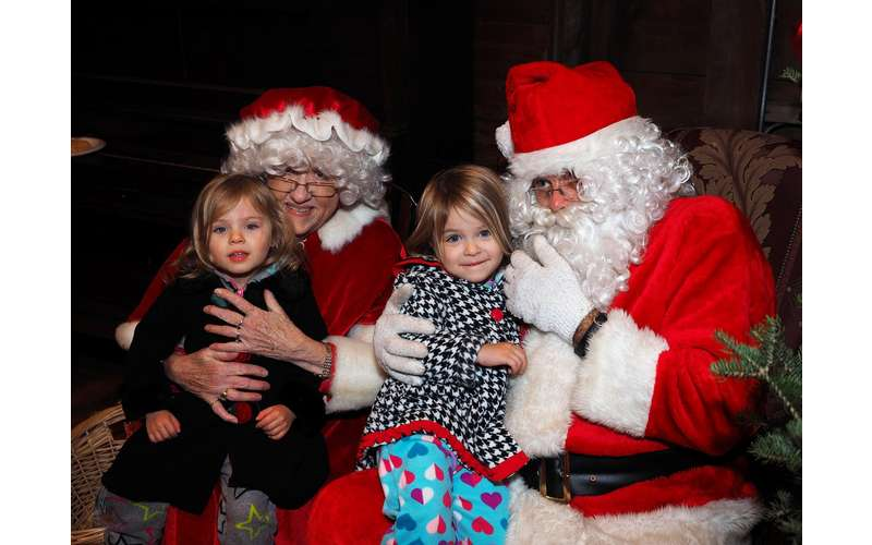 kids with Santa and Mrs. Claus