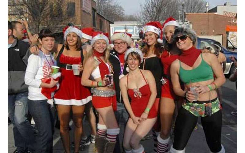 people posing in Christmas outfits